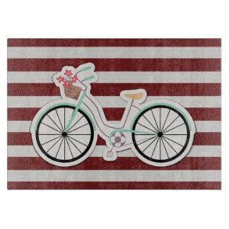 Planche À Découper Bicyclette avec le panier des fleurs