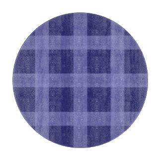 Planche à découper bleue de motif de plaid