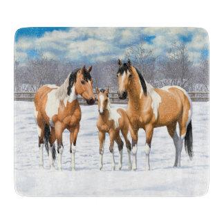 Planche À Découper Chevaux de peinture de peau de daim dans la neige