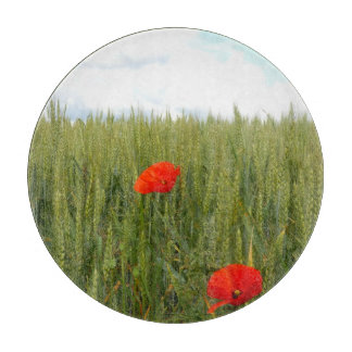 Planche À Découper Pavots dans un hachoir en verre de champ de blé