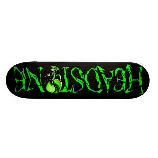 Planche à roulettes verte de logo de crâne de plateaux de skate