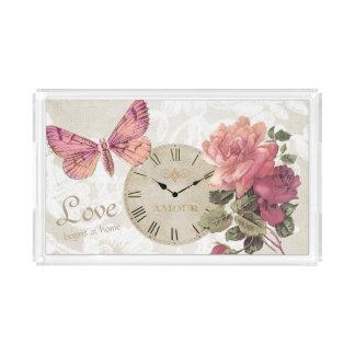 Plateau rose d'horloge de papillon d'amour de