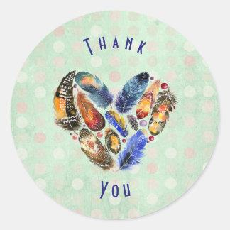 Plumes dans un Merci de forme de coeur Sticker Rond