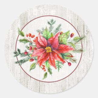Poinsettias rustiques d'aquarelle sur le bois sticker rond