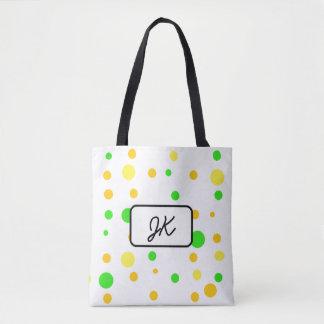 Point de polka décoré d'un monogramme et sac jaune