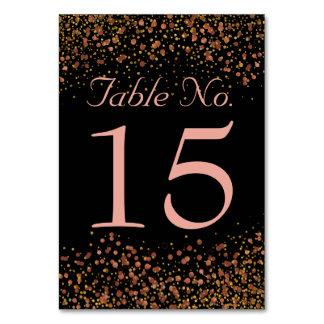 Points roses de confettis d'or des numéros   de carte