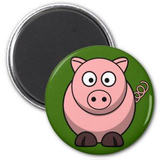 Porc rose mignon sur l'aimant de réfrigérateur d'h