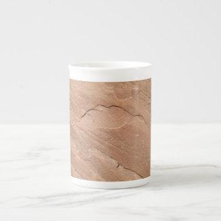 Porcelaine de tasse avec la copie de grès