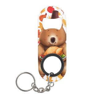 Porte-clé Décapsuleur ours de pilgram avec l'arrière - plan de fête