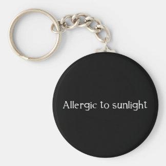 Porte-clés Allergique à la lumière du soleil