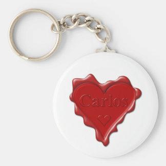 Porte-clés Carlos. Joint rouge de cire de coeur avec Carlos