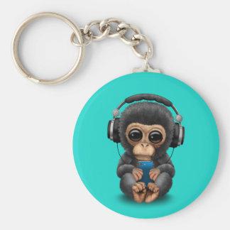 Porte-clés Chimpanzé de bébé avec les écouteurs et le
