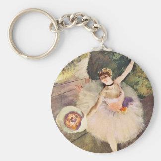 Porte-clés Dégazez la ballerine avec un bouquet des fleurs