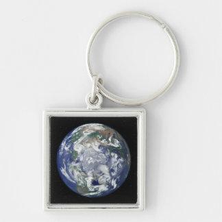 Porte-clés La terre entièrement allumée portée sur le Pôle