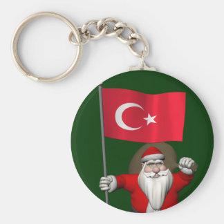 Porte-clés Le père noël gai avec le drapeau de la Turquie