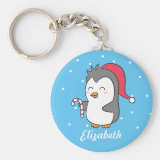 Porte-clés Le sucre de canne mignon de pingouin de Noël