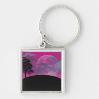 Porte-clés Lune rose d'imaginaire, nuages, silhouette noire