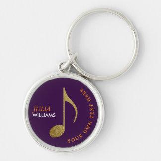 Porte-clés note musicale d'or sur le porte - clé pourpre avec