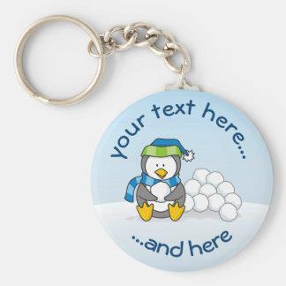 Porte-clés Petit pingouin se reposant avec des boules de