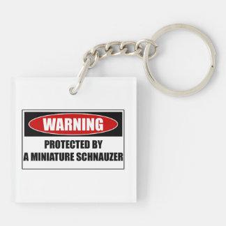 Porte-clés Protégé par un Schnauzer miniature