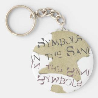 Porte-clés Symboles dans le sable
