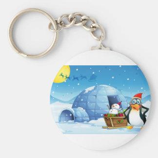 Porte-clés Un pingouin et le traîneau avec un bonhomme de