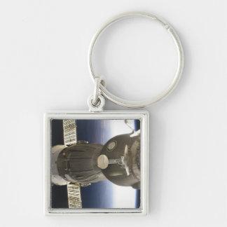 Porte-clés Un vaisseau spatial de Soyuz backdropped par la