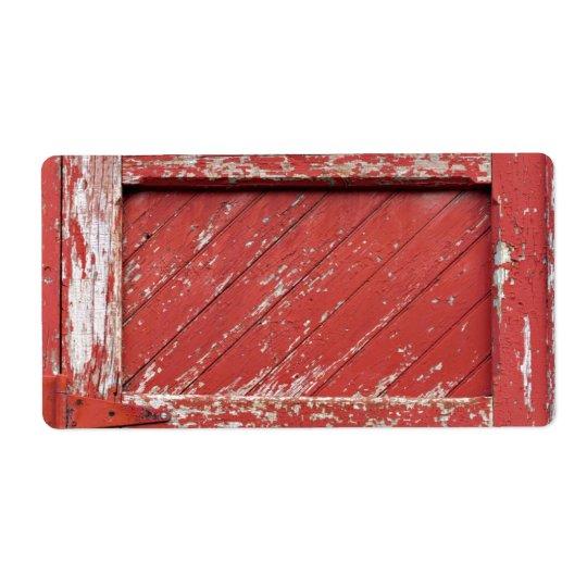 Porte de grange en bois peinte par rouge étiquettes d'expédition