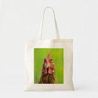 Portrait drôle de poulet sur le sac fourre-tout
