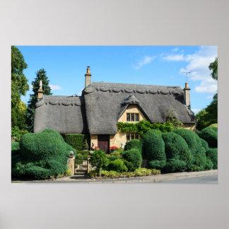 Poster Cottage de toit couvert de chaume en ébréchant