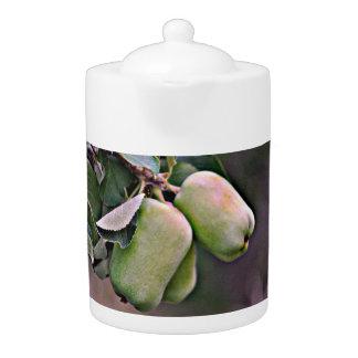 Pot vert de thé de pommes