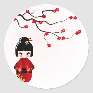 Poupée de Kokeshi sous la branche de Sakura Sticker Rond