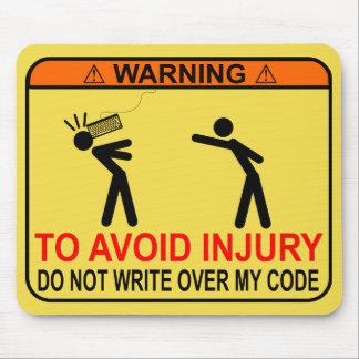 Pour éviter la blessure, n'écrivez pas au-dessus tapis de souris