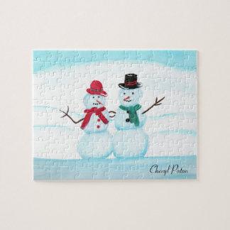 Puzzle Couples de personnes de neige ondulant salut,