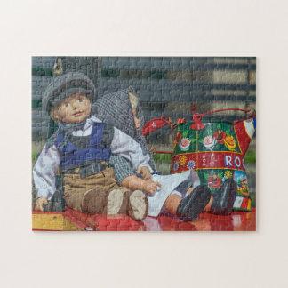 Puzzle de photo de poupées et de boîte d'arrosage