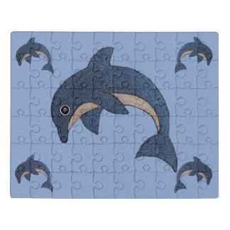 Puzzle Les dauphins blancs bleus sautants d'étincelle de