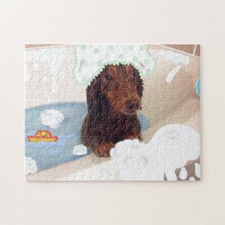 Puzzle mignon de baignoire de chien de teckel