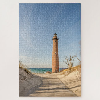 Puzzle Peu de phare de point de sable sur le lac Michigan