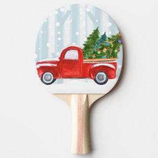 Raquette De Ping Pong Camion pick-up rouge de Noël sur une route de