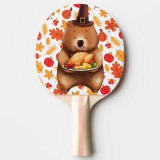 Raquette De Ping Pong ours de pilgram avec l'arrière - plan de fête