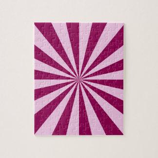 Rayons de soleil dans le puzzle rose et couleur
