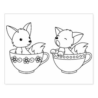 Renards de tasse de thé - animaux de bébé dans une