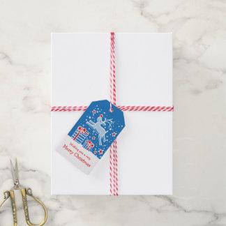 Étiquettes-cadeau Renne de Noël caracolant au-dessus des étiquettes