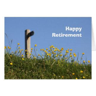 Renoncules et carte de retraite de signe de