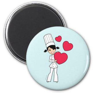 Rétro aimant de fille de cuisson