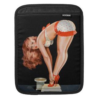 Rétro fille de pin-up drôle sur une échelle de poche iPad