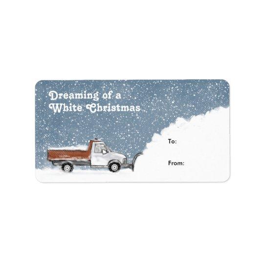 Rêver des étiquettes d'un cadeau de chasse-neige