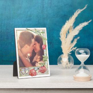 Roses et coeurs de symboles d'amour plaque photo