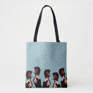 Roses et sac fourre-tout à mains