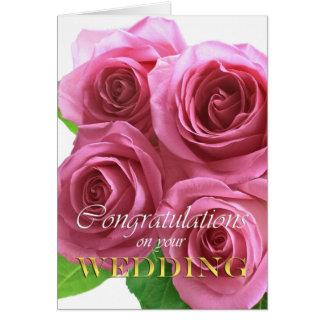 Roses roses, épousant la carte de félicitations